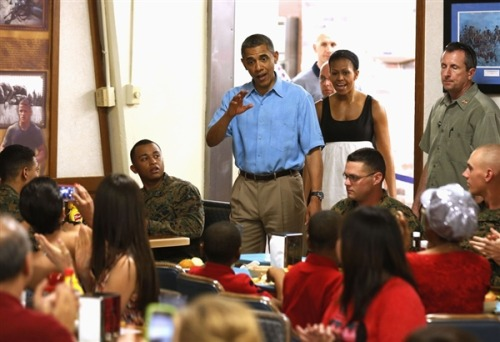 President Obama greets Marines in Hawaii on Christmas (Photo: Larry Downing / Reuters) KANEHOE, HAWAII – President Obama spent part of his last full day in Hawaii participating in an annual tradition for his wife Michelle and him: greeting Marines at the base near his vacation home here. Read the complete story.
