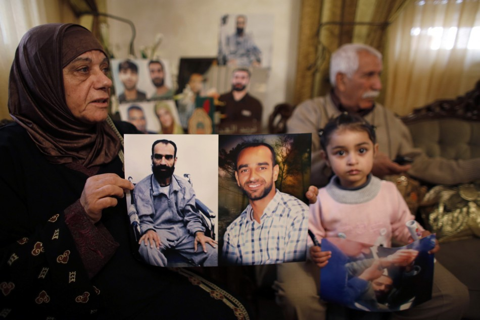 Samer al-Issawi's Israeli Detention Exposes Illegal Practices http://www.ibtimes.co.uk/articles/438313/20130222/samer-al-issawi-middle-east-palestine-israel.htm Layla al-Issawi holds a picture of her son Samer, who has been on hunger strike for 209 days while being held in an Israeli prison, at her home in the East Jerusalem neighbourhood of Issawiya February 17, 2013. (Photo: Reuters)