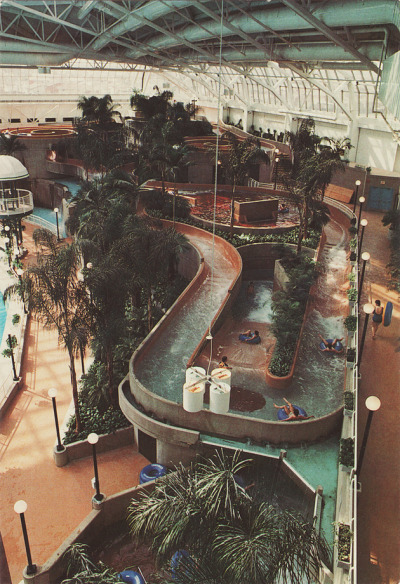 ois:      This is the waterpark at West Edmonton Mall. It looks very different now, but this is what the tube ride looked like when I was a kid. I went on those rides so many times in my childhood, I can still picture every turn and waterfall in my head. One time I got stuck and couldn't get myself moving again and my family was swept onwards with the current and other people kept going past and none of the lifeguards were around to help me and I thought I was going to be stuck there forever. Tube rides still make me feel very anxious.