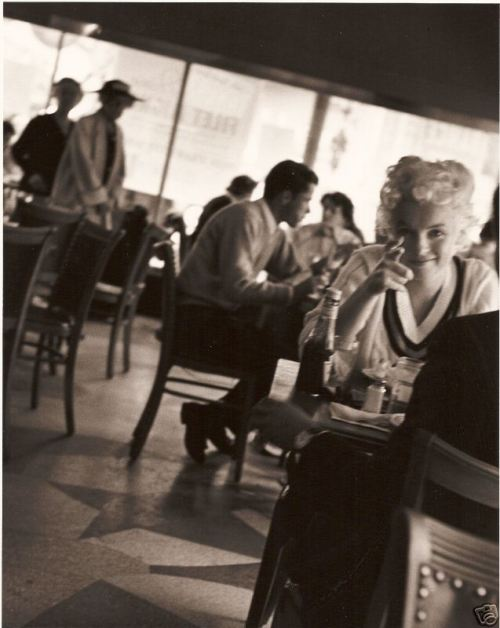 misspennydreadful:  One of my favorite rare images of Marilyn.  Taken by Roy Schatt, at a Childs Diner restaurant, New York City 1955