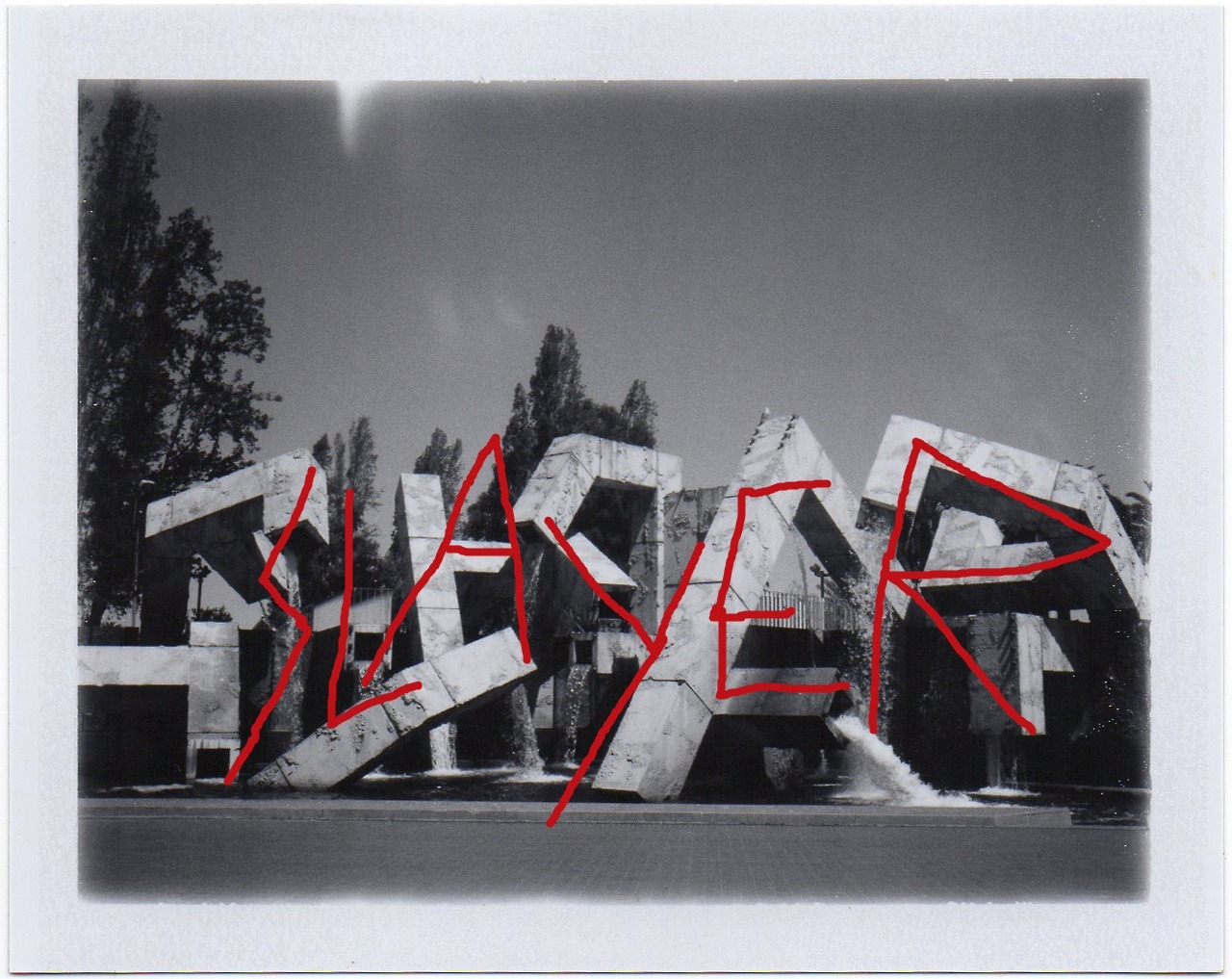 I've solved that fountain. Pre-Defaced Photo via polaroidsf