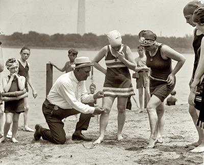 blakesby:  US Bikini Laws, 1922  June 30, 1922. Washington policeman Bill Norton measuring the distance between knee and suit at the Tidal Basin bathing beach after Col. Sherrell, Superintendent of Public Buildings and Grounds, issued an order that suits not be over six inches above the knee.  - National Photo Co.