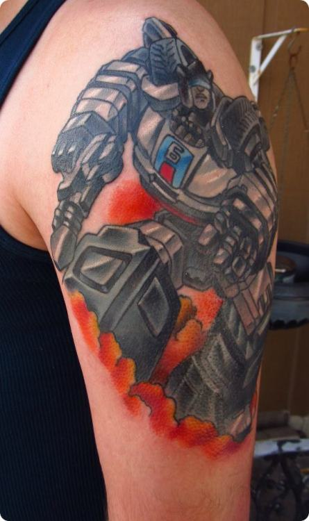 fuckyeahtattoos:  This is my new Transformer tattoo (Jazz). This was moments after it was done.. I had to do it in two sessions.  It was done by Jeremy Utley at Fat Brothers Tattoo in Highland, MI.. He did a great job and I love the way it turned out.
