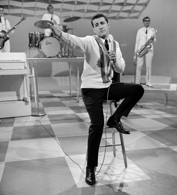 Alex Trebek Hosting Music Hop in 1964   Before hosting Jeopardy!, Alex Trebek got his start on CBC Radio. He started his career in 1961 and covered a range of topics. His first hosting gig was on the show Music Hop in 1963. - For more information check out the CBC.   Photo by: CBC Still Photo Collection / Barry Wilson Ed note: This 1950s game show guest had a secret: He saw Lincoln's assassination. h/t Reddit