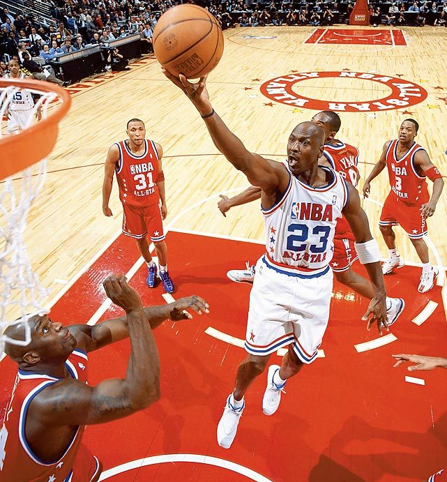 siphotos:  Michael Jordan glides in for a layup during the 2003 All-Star Game. Jordan, who started the game when Vince Carter gave up his starting spot, hit a baseline jumper with 4.8 second remaining in overtime to put the East up 138-136. Jermaine O'Neal ruined the fitting ending however, fouling Kobe Bryant on a three-pointer with one second left. When Bryant hit two of his three free throws, the game went to a second overtime for the first time in All-Star history. Kevin Garnett hit three jumpers in the post in the second bonus period and claimed the MVP honors as the West won 155-145. (Bob Rosato/SI) GALLERY: Memorable All-Star Game Moments