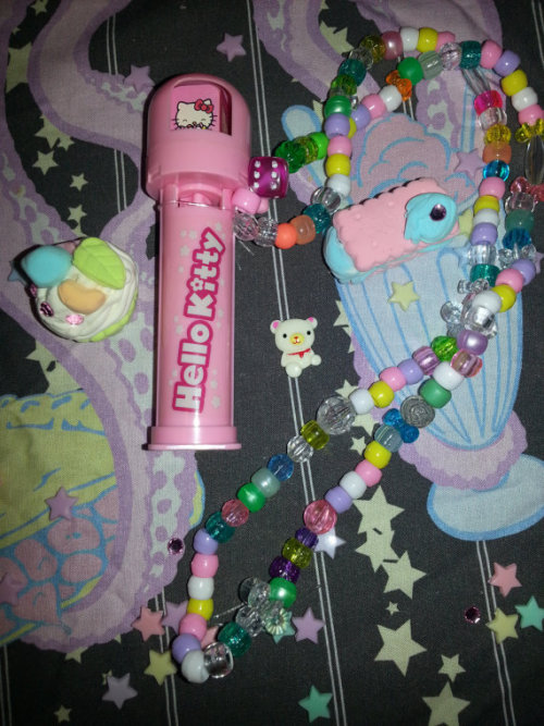 ~☆★Hello Kitty Kandi Necklace★☆~ This is a Hello Kitty pez dispenser kandi necklace. Feel free to load your kandi into it so you can have a snack with you during a rave!  Etsy Listing: https://www.etsy.com/listing/130580342/hello-kitty-kandi-necklace?ref=shop_home_active Facebook: https://www.Facebook.com/ThePandaFuzz