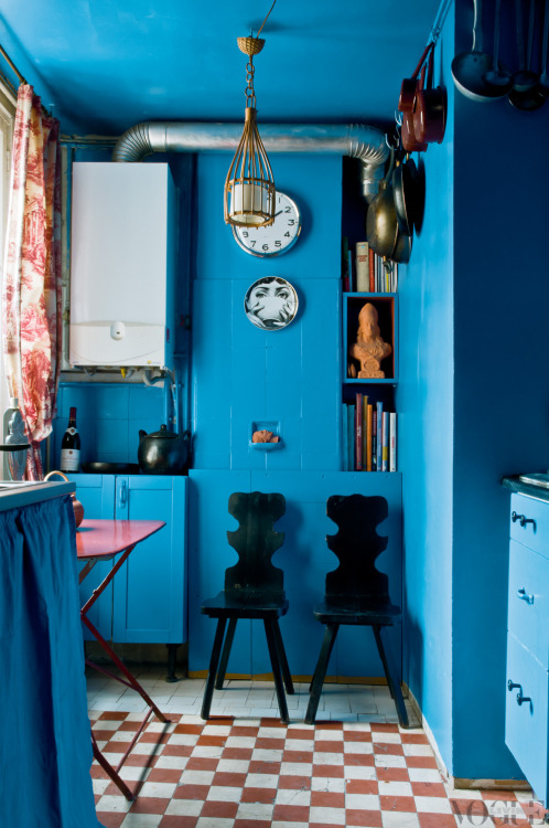 voguelivingmagazine:  The Paris home of designer Virginie Manivet features this jovial blue kitchen, complete with original 19th-century tiled floor, folding metal table, black lacquer chairs and toile de jouy curtains. From 'Eclectic Blue', a story on page 163 of Vogue Living May/June 2013. Photograph by Eric Morin.