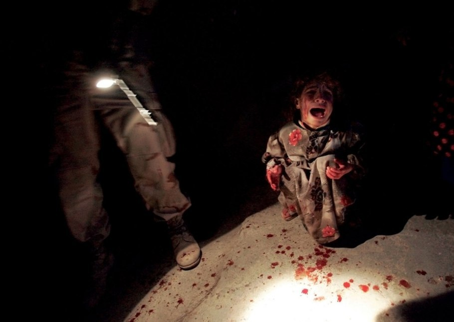 "fotojournalismus:  Not So Long Ago, In Iraq  (via Vanity Fair) ""It hasn't taken long for the Iraq war to feel like a relic of history. Although U.S. troops withdrew from the conflict a mere 17 months ago, the story of the war already seems set in a bygone era—circumstances that have quickly been buried under an avalanche of newer crises. Photojournalist Michael Kamber, who covered the war for The New York Times from 2003 to 2012, noticed America's desire to tune out the war while the battles were still raging. Visiting home while on leave during the war's early years, Kamber grew frustrated that Americans were ill informed about the conflict, leading, he felt, to a public that didn't care enough about the bloodshed he was documenting. His frustration grew as the conflict wore on, as the U.S. military took an active role in encouraging public indifference by censoring what could be photographed. Now Kamber has responded with Photojournalists on War: The Untold Stories from Iraq, a riveting account of the conflict as told by three dozen of the war's most prominent photographers. Kamber's interviews with his colleagues cover the war as they saw it—their passion for the story, their fears and daily complications, and the trauma they live with still today. Some of their images are among the most iconic of the war, some are previously unpublished, and many are gruesome, shocking, and utterly dispiriting.  The book is out on May 15, 2013, via University of Texas Press."" Photographs :  1. Six weeks before the start of the war, a man sits drinking tea at the Al Zahawi cafe on Rashid Street, Baghdad, February 12, 2003. (Bruno Stevens) 2. An Iraqi woman walks through a plume of smoke rising from a massive fire at a liquid gas factory as she searches for her husband. The fire was allegedly started by looters picking through the factory. Basra, May 26, 2003. (Lynsey Addario) 3. An Iraqi child jumps over remains of victims found in a mass grave south of Baghdad. The victims were killed by Saddam Hussein's government during a Shiite uprising here following the 1991 Gulf War. Al Musayyib, May 27, 2003. (Marco Di Lauro/Getty Images) 4. Samar Hassan,5, screams moments after her parents were killed by U.S soldiers from the 25th Infantry Division. The troops fired on the Hassan-family car when it unwittingly approached during a dusk patrol in the tense northern town. Tal Afar, January 18, 2005. (Chris Hondros/Getty Images) 5. Soldiers of the First Armored Division swim at Uday Hussein's abandoned palace. Baghdad, July 11, 2003. (Ed Kashi/VII) 6. 1,215 U.S.-military personnel pray during a massive re-enlistment ceremony in Al Faw Palace, one of Saddam Hussein's former luxurious homes. Baghdad, July 4, 2008. (Ashley Gilbertson/VII) 7. A U.S. soldier watches an Iraqi man who collapsed while being arrested during a raid. Ramadi, January 24, 2006. (Guy Calaf) 8. A man is arrested by U.S. soldiers on suspicion of corruption and complicity in working with anti-coalition insurgents. Baiji, February 8, 2008. (Eros Hoagland/Redux) 9. A U.S. soldier marks the back of a man's neck with numbers denoting his neighborhood and home, a system designed to help troops determine if people were moving around the village of Qubah despite a lockdown following a U.S. attack on insurgents. Qubah, March 24, 2007. (Yuri Kozyrev/Noor)  10. Rena was nine months pregnant and walking with her youngest sister in Sadr City one day in 2008, when a U.S. air strike tore off her leg, killing her unborn infant and her sister. Sadr City, February 2009. (Farah Nosh)"
