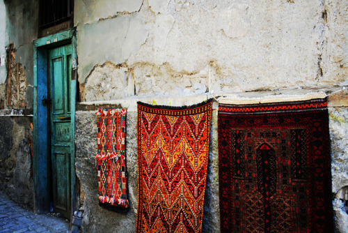 elorablue:  Turkish Rugs And A Door by Josh and Julie on Flickr.