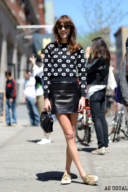 chung-alexa:  Alexa Chung wearing Karen Walker sunglasses, a daisy knit, leather skirt, Mulberry bag and Supergas. Daisy knit alternative - Daisy Jumper