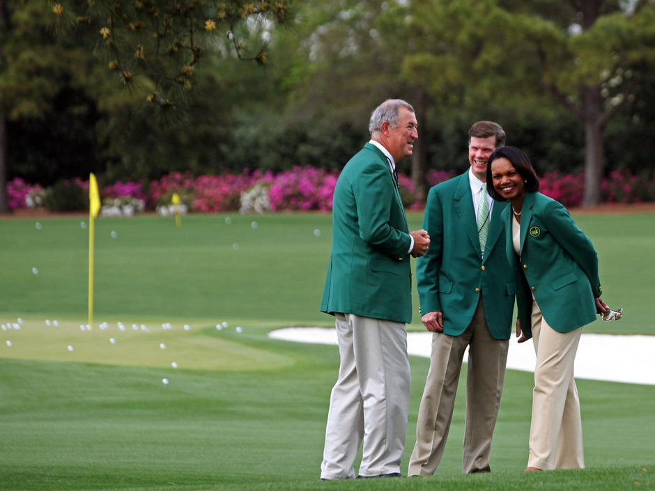 "nationalpostsports:  FINALLY: Condoleezza Rice shows off her green jacket ahead of the Masters.  The home of the Masters, under increasing criticism the last decade because of its all-male membership, invited the former secretary of state and South Carolina financier Darla Moore to become the first women in green jackets last August when the club opens for a new season in October. A debate about membership intensified in 2002 when Martha Burk of the National Council of Women's Organizations urged the club to include women among its members. Former club chairman Hootie Johnson stood his ground, even at the cost of losing Masters television sponsors for two years, when he famously said Augusta National might one day have a woman in a green jacket, ""but not at the point of a bayonet."" (Photo: Ron Williams/The Associated Press)"