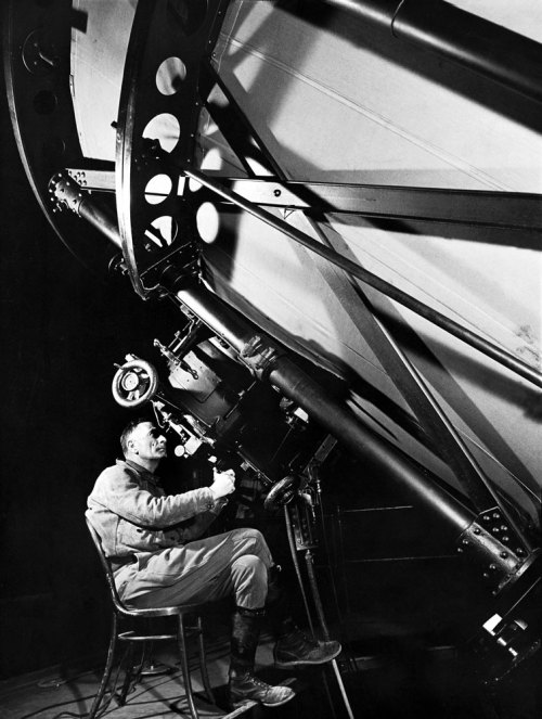life:  Today we look at a photograph of Edwin Hubble made in 1937 — arguably the single greatest photo ever made of a scientist at work. (Margaret Bourke-White—Time & Life Pictures/Getty Images)  I find it really cool that I am sitting right now about 150 ft away from where this was taken :)