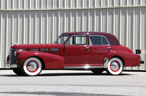 1938 Cadillac 60-special.  The first modern sedan.    Notice, there is a clear belt-line.  Also, the transition from the C-pillar to trunk is a true notch-back shape.  Also, this is one of the first examples of pure chrome window surrounds.  All in all, the first real 3-box shape.  Front (hood), middle (body), and rear (trunk). Really.  Find one before this.