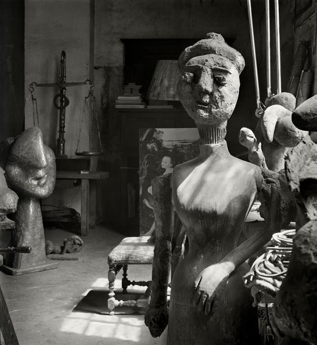 Herbert List    Rue des Grands Augustins  Paris. Pablo PICASSO's studio. Painting by Lucas CRANACH in the back.