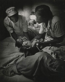 "thesewatersrundeep:  ""African American Midwife Maude Callen Delivering a Baby"" by W. Eugene Smith, 1951 One remarkable moment in the public depiction of the midwife occurred in December 1951, when in a photo-essay for Life magazine, W. Eugene Smith introduced Mrs. Maude Callen, a nurse midwife practicing in rural South Carolina. Callen traveled 36,000 miles a year over back roads to administer the only medical care many poor [B]lacks were likely to receive. Maude Callen persuaded [the Division of Maternal and Child Health assistant director] to secure Penn Center, originally a school for newly freed slaves, as a site for the [midwifery] institutes because of its symbolic value in the Lowcountry communities served disproportionally by midwives. Training took place in the historic school buildings beneath moss-draped live oaks on a barrier island claimed by [B]lack farm families after the Civil War. Participants frequently described the experience as ""inspirational."" Working in the rural South in the 1950s, in ""an area of some 400 square miles veined with muddy roads,"" as LIFE put it, Callen served as ""doctor, dietician, psychologist, bail-goer and friend"" to thousands of poor (most of them desperately poor) patients…After the piece was published, LIFE subscribers from all over the country sent donations, large and small, to help Mrs. Callen in what one reader called ""her magnificent endeavor""… Maude Callen died in 1990 at the age of 91 in Pineville, South Carolina, where she had lived, and served, for seven decades."