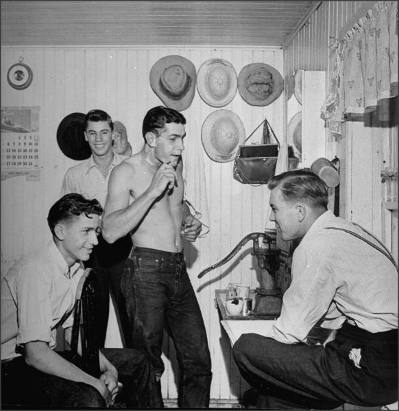 Teens, 1940s A Young sailor on leave visits with his friends.