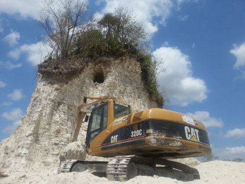 "shortformblog:  climateadaptation:  Road crews tear down Mayan pyramid to make gravel.  Belizean police are investigating a construction company that has destroyed most of one of the largest Mayan pyramids in the Caribbean nation to make gravel to dump on village roads, according to reports from the Caribbean. Archaeologists and a local TV station witnessed the destruction Friday as bulldozers and excavators continued to demolish the 60-foot-tall main temple at Nohmul — ""great mound"" — one of the tallest structures in northern Belize, along the Mexican border in the Yucatan Peninsula. ""We can't salvage what has happened out here,"" John Morris, of the Institute of Archaeology, told 7 News Belize. ""It is an incredible display of ignorance. I am appalled."" A news crew was threatened by a man with a machete as dump trucks hauled away rock and limestone from the temple, which has been ""whittled down to a narrow core,"" the TV station said. A Caterpillar excavator was photographed tearing down what was left of the limestone-rich ruins. ""It's like being punched in the stomach, it's just so horrendous,"" Jamie Awe, head of the institute, told the Associated Press. ""These guys knew that this was an ancient structure. It's just bloody laziness."" The pre-Colombian site is about 2,500 years old and consists of twin ceremonial clusters surrounded by 10 plazas and connected by a raised causeway. Mayans used stone tools to quarry the rock and build the complex by hand. An estimated 40,000 people are believed to have lived there between 500 and 250 BC.  More of these incidents to come in the years ahead as population growth outweighs the need to protect resources.  This is just sad in every way, made us feel heartsick. It stays standing for 2,500 years, only to end up ""gravel to dump on village roads.""  at first, i thought, ""wow what dumbasses.  that shit is irreparable/irreplacable.""then i read 'end up gravel to dump on village roads' and thought it was nice and kind of poetic.  also i hold nothing sacred.  so i don't really care about old ass artifacts."