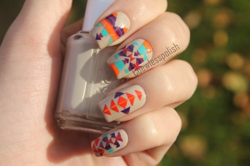 I love all the colors in this Aztec print nail.   For more fun nail design ideas, check out this Danish nail blog!