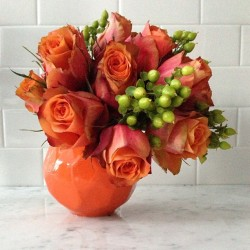 A cute #asymmetrical #flowerarrangement in an #orange #vase. (Had enough #flowers today folks?)