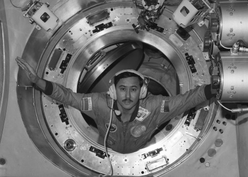 Talgat Musabayev as a backup for the Soyuz TM-13 mission. The patch on his right is for the Kazakh Soviet Republic. As this flight was after the breakup of the Soviet Union, it was a good will gesture to include a Kazakh cosmonaut. The Russian space agency wanted to continue to use Baikonur, which is in Kazakhstan. (1991) (Source)
