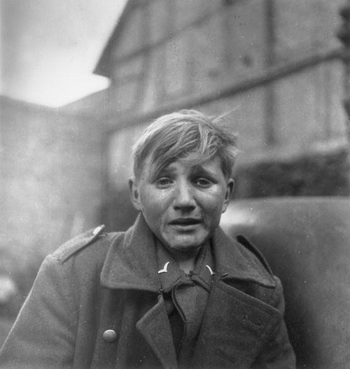 sinuses:  April 1945: Fifteen year old German soldier, Hans-Georg Henke, cries after being captured in Germany. His father died 1938 and his mother in 1944. After his mother's death, a neighbor had him drafted into the military so he could be taken care of. When the war was coming to an end he walked 60 miles to try and reach American lines only to be captured by the Russians. Henke, along with his two brothers, survived the war and he went on to live a full life. He died in 1997 in Finsterwalde, Germany.