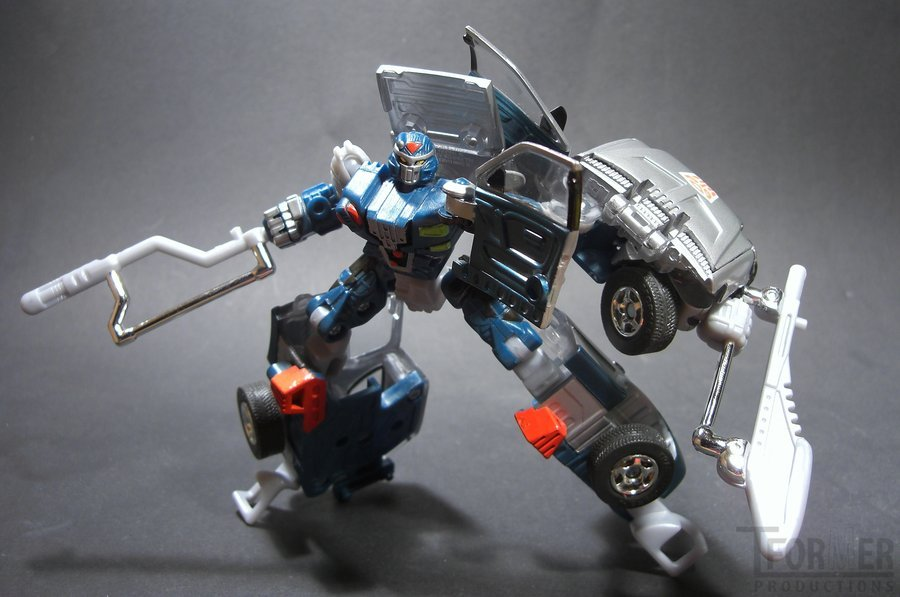 RiD X-Brawn 5 by ~Tformer on deviantART still love the car brothers, they were the first modern autobot cars after five years of beasts and space tanks (and actually the first transformers i ever had that turned into any kind of realistic vehicle since i grew up on pretenders).  they were kind of a mess, but they also had giant red-chromed autobot logos molded onto them and beast wars articulation.  x-brawn's giant hand can give a thumbs up and that is basically always cool.
