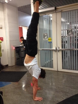 nathanadrianappreciationblog:  Nathan doing a handstand.