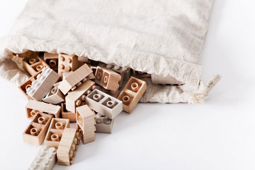 designcloud:  Wooden LEGO blocks by Mokurokku Japanese firm Mokurokku hopes to get you feel closer to nature with their new wooden bricks. Each box of mokulock bricks is priced at ¥2,835/USD31 and includes 50 pieces. they seem to be compatible with standard LEGO pieces, and we would want to see sets of mixed plastic and wood construction on different textures and colors. the mokurukku set has a disclaimer that the pieces can warp or fit together imprecisely due to the nature of the material in different temperatures and scale of humidity..