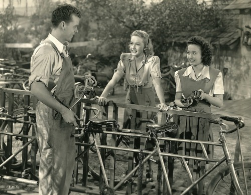 Jackie Moran, Bonita Granville and Jane Powell fix bikes.
