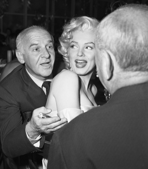 Journalist Walter Winchell, chats with Joseph Schneck,while Marilyn Monroe scopes out the place on 1953