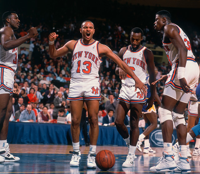Mark Jackson celebrates after a three-point play during a 1988 game against the Lakers. Jackson, now coach of the Golden State Warriors, is the early pick for Coach of the Year, according to SI's Ian Thomsen. (Manny Millan/SI) GALLERY: Rare Photos of Mark Jackson