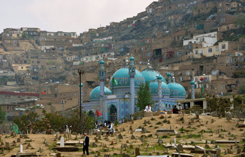 Afghans at the Karte Sakhi cemetery on the foot of Karte Sakhi's Shrine in the foothills of TV Mountain in Kabul, on April 26, 2013. The shrine is the second most sacred place of Shia worship in Afghanistan. Picture: Manjunath Kiran/AFP/Getty Images