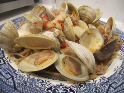 Steamed Clams with Fennel and Sausage Local wild little-neck clams were on sale at FreshDirect, so I decided to give this recipe a try.  I'm not a fan of East Coast clams.  Every time I cook these clams it makes me homesick for the sweet and tasty little Manila clams of my Seattle youth.  I know Manila clams are an invasive species that came over from Japan.  So if they invaded the West Coast, can't they invade the East Coast, too?  Maybe one day.  Until then, these little-necks did a fine job, and the spicy Italian sausage added a great flavor contrast.  I'll make this recipe again - maybe next time with Manilas.