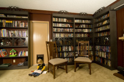 Secret sliding bookcase conceals hidden door