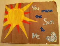 you mean the sun to me. fabric and map machine sewn on brown paper bag. february 2013