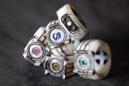 copiouslygeeky:  3D Printed Portal Rings The prices on these range anywhere from $10 to $100 based on the material you choose to print them with.  Created by Ammnra