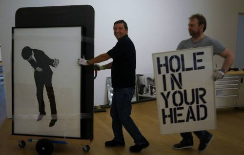 "installator:  ""Transporting 'Untitled' by Christopher Wool, 1992 (right) and part of the triptych 'Untitled (Men in the Cities) by Robert Longo (left).""Foto: Martijn van Nieuwenhuyzen(Stedelijk)"
