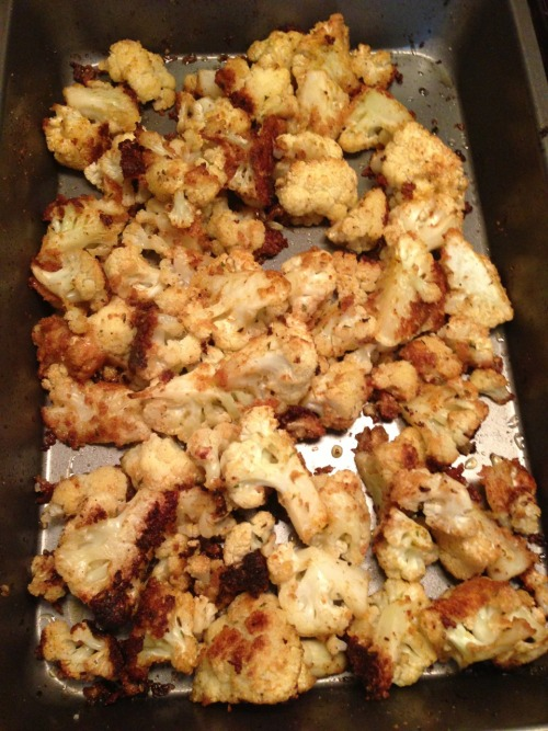 Oven Roasted Cauliflower   1 head of cauliflower Breadcrumbs Parmesan cheese Tony's  Garlic powder  Olive oil  Preheat oven to 425.   Chop cauliflower into bite size pieces.   Drizzle with olive oil. Toss cauliflower to coat. Sprinkle with a heavy hand Tonys, garlic powder, Parmesan cheese, and breadcrumbs. Toss to evenly coat. Add more olive oil if to dry.  Bake for 25 minutes stirring once.