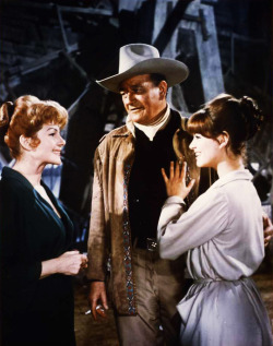 Rita Hayworth, Claudia Cardinale and John Wayne in Circus World (1964)