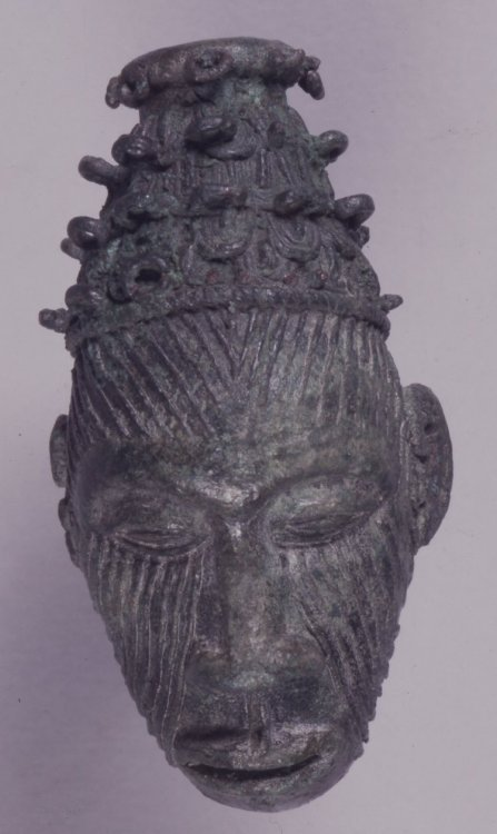 ukpuru:  Igbo rass human-head pendant found in Igbo-Ukwu in Igbo country. Dated from the 9th century. In British Museum display.