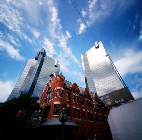 1901 & 1984 - Pinhole on Flickr.Via Flickr: The City Center towers rise above the historic Knights of Pythias Castle Hall in downtown Fort Worth.  Taken with my Zero Image pinhole. Think I got a little bit of film looseness here, evidenced by the distortion.