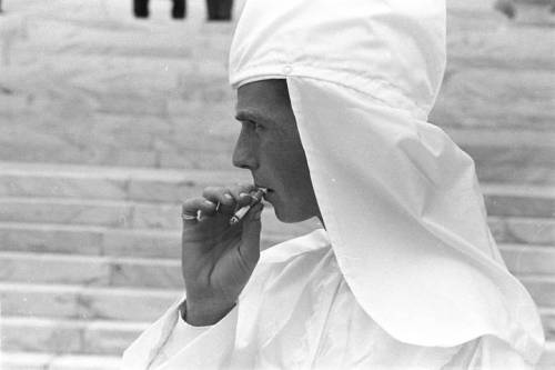 An old-school racist enjoys a smoke at a Klu Klux Klan rally in Montgomery, Alabama. December 10, 1967. Photo by Jim Peppler. Courtesy of the Alabama Dept. of History & Archives.