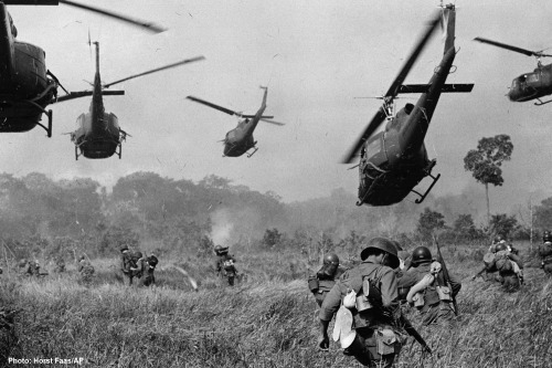 American helicopters pour machine gun fire into the tree line to cover the advance of South Vietnamese troops in an attack on a Viet Cong camp 18 miles north of Tay Ninh, Vietnam.March 1965 Photograph by Horst Faas/AP