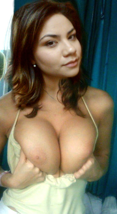 Sexy brunette shows her sweet big natural boobs