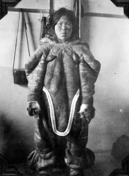Inuit woman dressed in her indoor winter clothes, Unknown Location, N.W.T. [Nunavut?], 1929. Signatures and inscriptions - Eskimo woman, Hudson Bay west Coast, indoor winter clothes, note stockings. Credit: G.H. Blanchet / Library and Archives Canada / e004665346Restrictions on use: NilCopyright: Library and Archives Canada Source