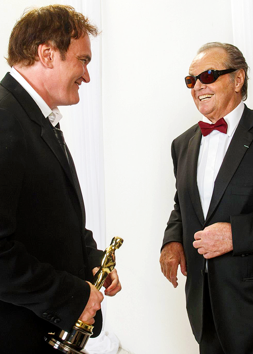 Quentin Tarantino poses backstage with Jack Nicholson during the Oscars.