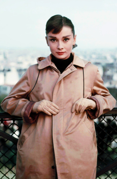 Audrey Hepburn photographed atop the Eiffel Tower during the production of Funny Face, 1956.