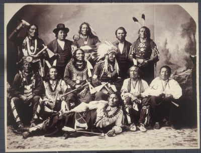 centuriespast:  Studio portrait of Ponca Delegation. Back row, left to right: Big Snake (Wase-A-Tonga), Baptiste Barnaby (interpreter), White Eagle, Charles LeClaire (interpreter), The Chief (Ga-hi-ge). Middle row, left to right: Black Crow (Kha-Ka-Sapa), Big Elk (On-Pon-Ton-Ga), Standing Bear (Mon-Chu-Non-Zhin), Chief Standing Buffalo Bull (Ta-Ton-Ga-Non-Zhin), White Swan (Mi-Xa-Cka, Frank Lafleshe), Smoke Maker (Shu-De-Ga-Xe). Front row: Hairy Grizzly Bear (Mon-Chu-Hin-Xte). Most are wearing traditional clothing, including bear claw necklaces, feather headdresses,and peace medals. November 14, 1877 National Museum of the American Indian