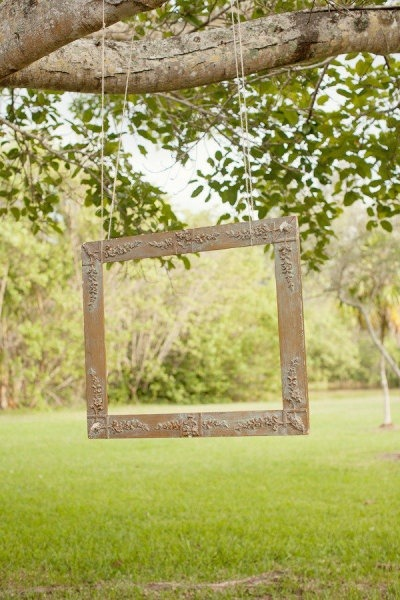 hang a large empty photo frame up at your next outdoor event (cough cough wedding) with a disposable camera nearby. you may finally get some pictures of the family that will last a lifetime.