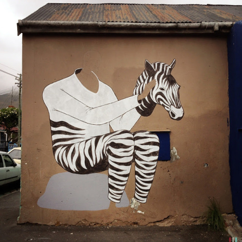 Interesni Kazki New Mural In Progress, Cape Town, South Africa StreetArtNews, streetartnews.net After several murals in India (covered), AEC from Interesni Kazki is now South Africa for a one month stay in Cape Town with A Word Of Art.Yesterday in Woodstock, the Ukrainian painter started working on this new piece which should be complete…